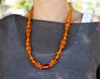 Applejuice Bakelite Carved Bead Necklace Translucent
