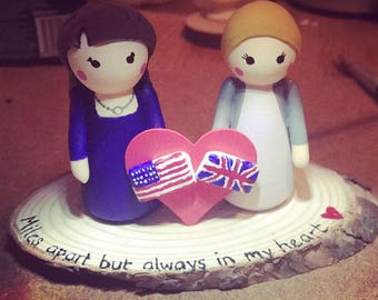 Friendship across the miles peg dolls with USA and UK flag detail.  Can be personalised to own preferences.