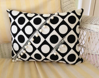 Black and white polka dot pillow with large pearls