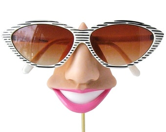 Smiling eyeglass holder, nose sunglasses display,  eyewear display stand