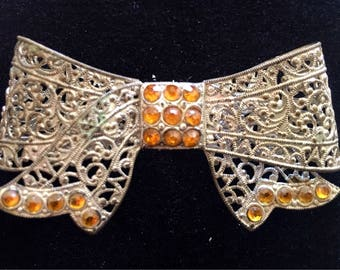 Bow brooch. Filigree bow brooch with orange stones