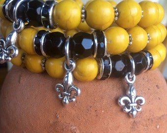 New Orleans Saints yoga bracelet with yellow howlite, black jade beads and metal charm