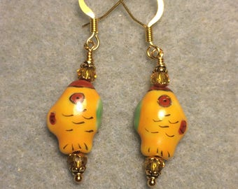Tangerine, red, and green ceramic fish bead earrings adorned with tangerine Chinese crystal beads.