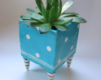 beautiful Turquoise pottery Planter with white polka-dots whimsical Black & White striped beetlejuice legs, Burtonesque feet
