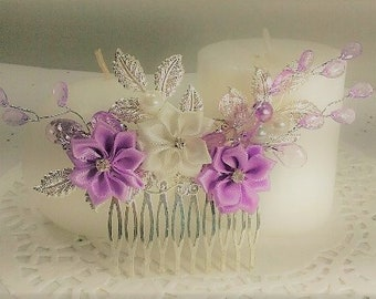 Polyester Purple and White Rosette Flower Hair Comb with Silve Leaves and Purple Beaded Vines.  Also has matching purple and white pearls.