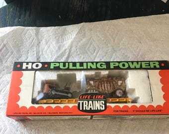 HO fivegraces bandwagon car with tractor in its box. t 587