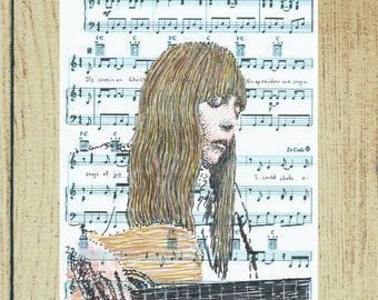 Joni Mitchell, in her own tune, Carey, from the album Blue - a charming portrait that captures the singer's quiet intensity