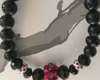 Black onyx necklace with red center bauble and rhinestones