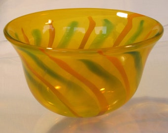 "Hand blown ""old gold"" glass bowl with orange and green stripes"