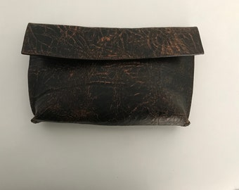Distressed brown clutch
