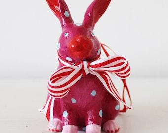 Hand painted hanging rabbit decoration.