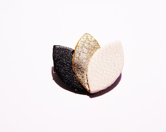 Black leather, gold and beige petals brooch