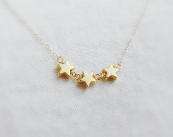 Shooting stars (necklace) - Three 14k gold plated star charms on a dainty 14k Gold Filled chain