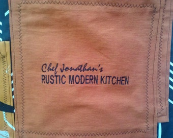 Embroidery on apron or pocket.