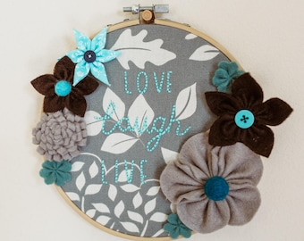 Embroidery Hoop Wall Art with Hand Made Fabric and Felt Flowers and Love Laugh Live Embroidery
