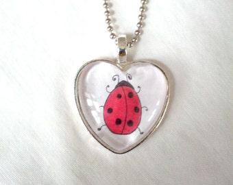 Lovely Ladybug Glass Heart Pendant. Lovingly Handmade in Brooklyn by Wishing Well Studio.