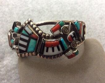 Fabulous vintageSterling Zuni man cuff bracelet signed GN Gary Navajo
