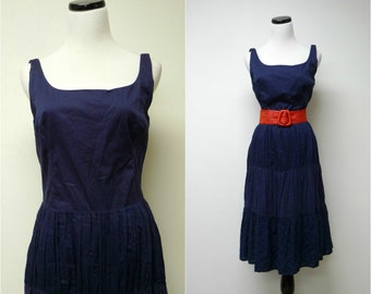 3 sisters . full skirt . dark blue sleeveless dress . size small to medium . bust  34""