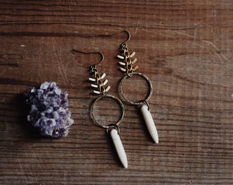 wilderness calling. a pair of fishbone and howlite dangle hoop earrings.