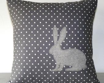 Grey spot cushion with hare appliqué