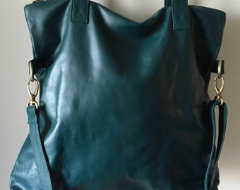 Genuine leather shoulder tote. Our Traveller bag is so unique.Long strap and stitched handles the perfect,lined shoulder bag