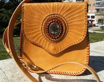 Embossed leather Handbags