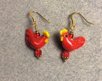 Red lampwork chicken bead earrings adorned with red Czech glass beads.