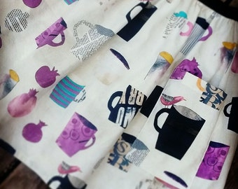 L. Coffee skirt. One large pocket. 100% cotton, off white, with zipper. Birds, mugs, and pomegranates.