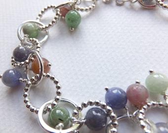 Silver bracelet with multi-coloured gemstone beads