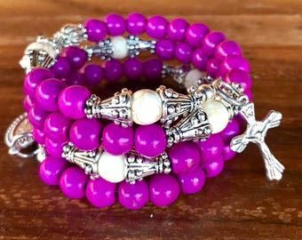 Handmade 5 decade rosary wrap bracelet in purple and white 6mm turquoise beads. Memory wire cuff bracelet with five decades, crucifix, charm