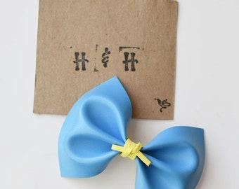 Light Blue Faux Leather Bow