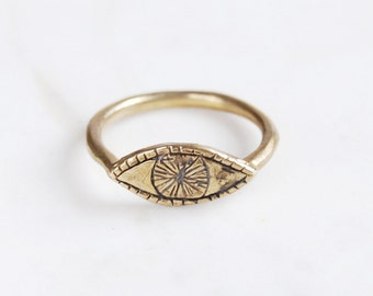 Golden watchful eye ring