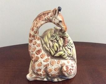 A Ceramic Giraffe Bell Figurine, UCCI.