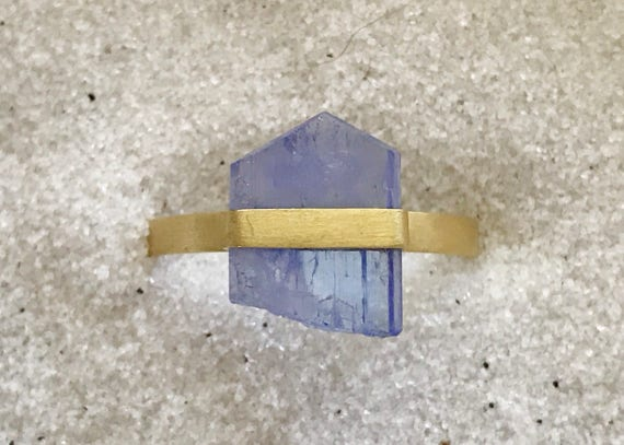 Untreated tanzanite crystal and solid 22k gold ring