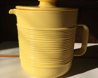Charming yellow pitcher, vintage