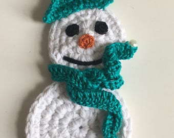 Crochet snowman with green hat and scarf magnet