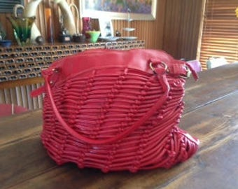 Large red PVC handbag with interesting knotted detail
