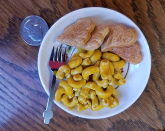 Macaroni and Cheese and Dino nuggets inspired by American Girl and intended for dollplay