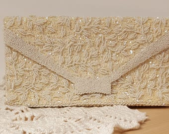Vintage Beaded and Sequined Satin Ivory made in Hong Kong presented by Donellensvintage