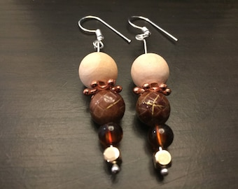 Pair of brown glass bead earrings with faux pearl