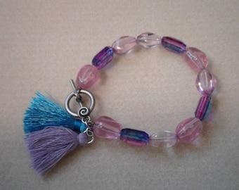 Lavender and blue bracelet with tassels