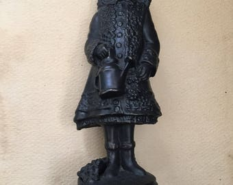 Bronze statue of Renoirs painting little girl with watering can