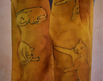 Silk charmeuse scarf, copper and gold with playful cats.
