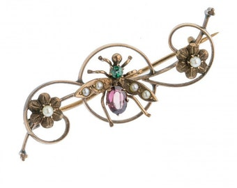 Victorian insect pin in rose gold with blue zircon, garnet and seed pearls. pnvc764(e)