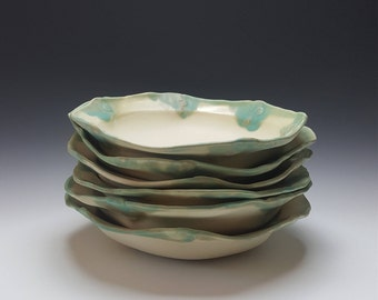 Handmade serving bowl by Potteryi. 3 left.  Can be bought individually or as a set. Ceramic bowl with turquoise rim.