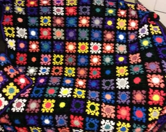 Granny square kaleidoscope design crocheted blanket afghan throw with pillow