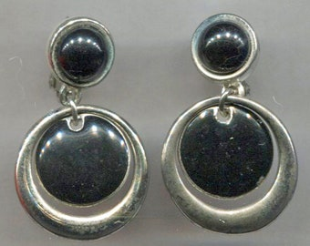 LCI Black Disc In Silver Hoop Clip-Back Earrings