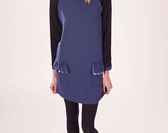 Blue and black dress dress long sleeve bicolor. details pockets flouncy and bow on the neckline