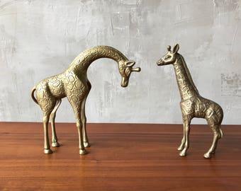 Pair brass giraffes