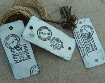 Lots of metal with postmark print 3 tags